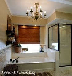 Paint the shower trim from awful gold to oiled bronze, strip wallpaper and add tile, and update the lighting. Voila!