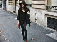 absolute parisian perfection! head-to-toe in black never looked so good! zara boots + zara top on gamine-de-paris (gaminedeparis) in paris | oversized felt fedora | oversized loose black cardigan | loose drapey slouchy neck tank | skinny jeans | knee-high tall boots with a chunky brown heel
