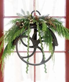 A vintage pulley for a Christmas wreath... perfectly charming!