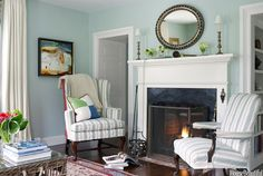 Nantucket Cottage by Gary McBournie - Palladian Blue walls, striped slipcovers, oval mirror, fireplace Cottage Living, Home Living Room, Living Spaces, Cozy Cottage, Country Living, Cottage Style, Wall Colors, House Colors, Paint Colors