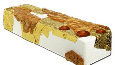 """""""La Bûche d'Yquem"""" is covered in gold leaf, scented with réglisse (licorice) and has a heart of dried apricot, lemon and hazelnut."""
