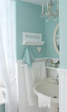 This vintage style guest bathroom from Carolyn, of Home Garden Tips, is full of sweet and charming details. Carolyn paired the deep aqua color of Marina Isle with subtle cream and bright white accents. Check out the rest of Carolyn's post as she walks you through her DIY process for remodeling this rustic bathroom.