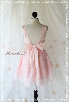 A Party Dress - Sweet Peachy Pink Lace Backless Deep Back Dress Bow Tie Back. $59.80, via Etsy.