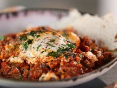 Moroccan Eggs with Flatbread and Goat Cheese recipe from Bobby Flay via Food Network