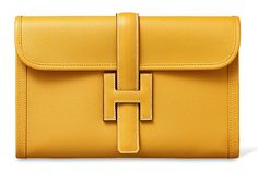 Presenting the Hermes Jige Clutch Bag. This classic clutch from Hermes have been around for years. It is a flat clutch with the H logo as a Hermes Clutch, Hermes Bags, Hermes Handbags, Hermes Birkin, Yellow Purses, Yellow Handbag, Birkin Bag Price, Cluch Bag, Luxury Purses