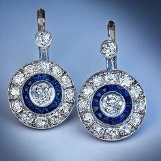 Original Art Deco platinum topped gold halo earrings embellished with almost 5 carats of diamonds accented with calibre cut sapphires, Portuguese 1920s