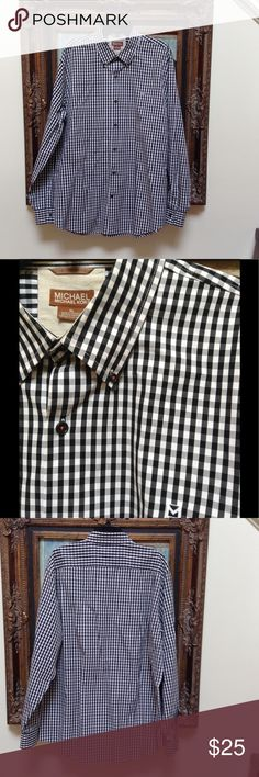 Men Michael Kors shirt I'm XL Black and white men's Michael Kors shirt in XL.  The thread on the buttons are a rust color.  Great conditions.  If you have questions please ask. MICHAEL Michael Kors Shirts Casual Button Down Shirts