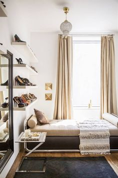 nate berkus jeremiah brent domino rita hazan apt bedroom neutral glam black white chrome daybed moroccan wedding blanket shoe shelves