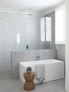 15 stunning bathrooms with no white tiles Restrained and gorgeous, the fish scale marble feature wall paired with soft grey floor and wall tiles are understated and elegant - Marble Bathroom Dreams Grey Bathrooms, White Bathroom, Beautiful Bathrooms, Luxury Bathrooms, Bathroom Mirrors, Master Bathrooms, Bathroom Feature Wall Tile, French Bathroom, Marble Bathrooms