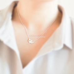 Hey, I found this really awesome Etsy listing at https://www.etsy.com/listing/214233905/tiny-dinosaur-necklace-in-gold-or-silver