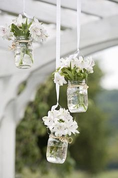 Outdoor ceremony altar decor idea -hanging glass jars filled with flowers {Rebecca Denton Photography}
