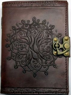 "Tree of Life Leather Embossed Journal with Handmade Linen Parchment Paper. Comes with a metal lock closure. Unlined 168 pages. 5"" x 7""."
