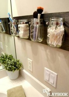 Hang mason jars for adorable off the counter bathroom storage // Storage Solutions