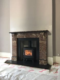 Chesney's Salisbury 5 wood burning stove - Marble Surround - Honed Slate Hearth - Painted Fire Board Chamber