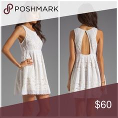 NWT Free People Brand New White Lace Dress Tags attached! Purchased for $128 new. White lace with yellow lining. Size 2 Free People Dresses Mini