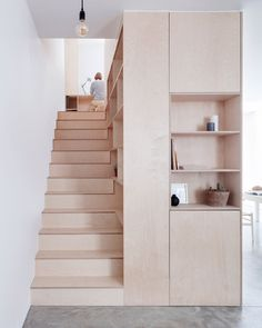 A plywood box hosts the kitchen and staircase in this maisonette in Islington, which has been reconfigured and extended by Larissa Johnston.