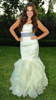Khole Kardashian Odom: September 2009. Khloe wore an ivory strapless Vera Wang gown with a mermaid tail. Khloe emphasized her slim waist with a purple jewelled sash for her wedding to basketball star Lamar Odom.