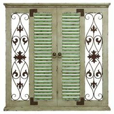 "Add a touch of rustic country charm to your home with this window-inspired wood and metal wall decor, showcasing scroll and fleur-de-lis detail.    Product: Wall decorConstruction Material: Wood and metalColor: Sage and rustFeatures: Warm and inviting designDimensions: 40"" H x 40"" W x 2"" D"