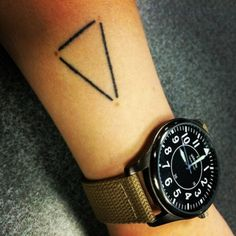 Little forearm tattoo of a triangle on Grace Jacobsen. A...