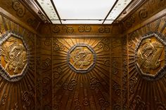 I came across this amazingly ornate bronze lift in the Museum of London. This lift was one of several installed in Selfridges department store in 1928. The interior metal panels depicting cranes and known as Les Cigognes d'Alsace were designed by Edgar William Brandt (1886-1960). The metalwork of the exterior screens with figures representing the signs of the zodiac was made by the Birmingham Guild of Metalworker and incorporate the work of Walter Gilbert and his assistant Louis…