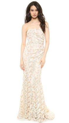 Intricate, two-tone floral lace brings a charming element to this striking Badgley Mischka gown