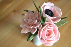 Pink Felt Flower Bouquet Brighten up any room with an heirloom felt flower bouquet! This bouquet is perfect for any occasion including for Mothers Day, a wedding, a special gift, or birthdays. Each petal and leaf is cut and assembled by hand. Thus every flower and stem is one of a kind