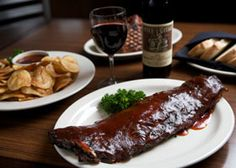 Montgomery Inn- Cincinnati, OH. Must try ribs, chips, and special sauce!  The ONLY place to eat RIBS!
