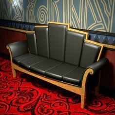Art Deco sofa, chair rail & wall paper.