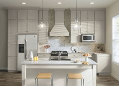 Light-colored cabinets can now be as durable as they are beautiful with Aristokraft's PureStyle™ collection. The Durham cabinets in this light, open kitchen feature one of Aristokraft's newest finishes, Glacier Gray.