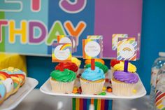 Colorful cupcakes at a rainbow birthday party! See more party planning ideas at CatchMyParty.com!