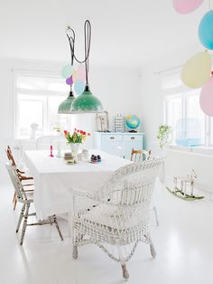 Dining room - very simple and white with  touches of pastel
