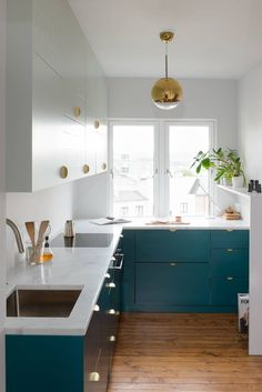 Modern teal kitchen cabinets