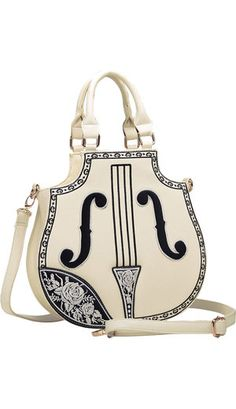 A cream violin shaped handbag with embroidered rose detail, strings etc. It is a zip up bag with secret compartment to the back and another inside. Comes with a shoulder strap. H:30cm D:9cm W:31cm