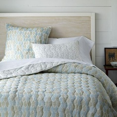 Our current bedroom quilt - wondering if I can pair it with a coral-covered pin tuck duvet . . . this quilt isn't fancy, but it's incredibly soft.