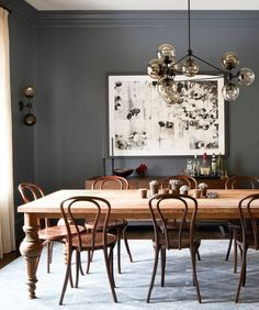 vintage dining table with bent-wood chairs and dark grey walls