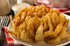 Appetizer Recipe: Classic Blooming Onions --- http://12tomatoes.com/2014/10/restaurant-appetizer-recipe-classic-blooming-onion.html