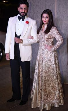 Abhishek and Aishwarya Rai Bachchan at Manish Malhotra's Birthday Do : Abhishek looked nice in a white tuxedo jacket with black pants and vest. As for Aishwarya, she opted for a gold Manish Malhotra long kurta and lehenga, which as much as I. Indian Fashion Dresses, Indian Gowns Dresses, Indian Designer Outfits, Indian Outfits, Bridal Dresses, Indian Attire, Pakistani Dresses, Asian Fashion, Women's Fashion