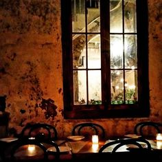 #nola #NewOrleans #FrenchQuarter #cocktails #rum #Louisiana #haunted #dinner #table #candles #window #windowpane by havanarum