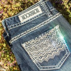 This fun dark wash jean from Rock and Roll Cowgirl has some shine, some sparkle and some unique zig zag stitching