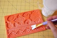 Step 1 - Fondant Molds = Dusting the Mold with Cornstartch