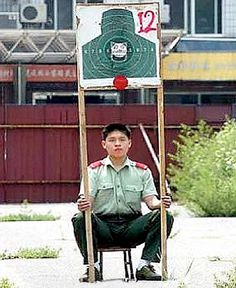 Sitting target: This Chinese man hopes his colleagues are a good shot