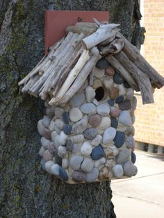 great stones on birdhouse