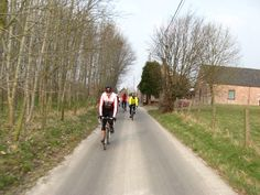 Riding quiet country roads in Flanders, Belgium. Custom tours are available every spring and summer.