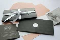Gift voucher design for La Belle Salon featuring a silver foil seal and custom-printed ribbon