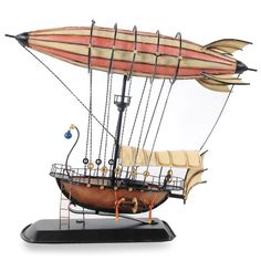 Science fiction buffs are sure to appreciate the engineering behind this steampunk airship model, which features a blimp attached to a boat base. Dirigible Steampunk, American Flag History, Steampunk Ship, Dammit Doll, Pirate Games, Steampunk Gadgets, Steampunk Accessories, Boat Design, Art Portfolio
