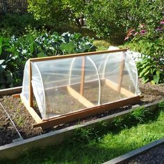 DIY: Portable Garden Cloche Plans Cloche closed with side vents open (note, cloche itself not for sale: just the plans) Outdoor Greenhouse, Cheap Greenhouse, Portable Greenhouse, Greenhouse Interiors, Backyard Greenhouse, Greenhouse Plans, Greenhouse Wedding, Homemade Greenhouse, Aquaponics System