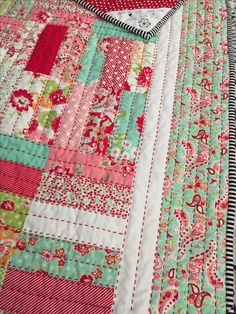 Big stitch using Jelly Roll Jam pattern in Scrumptious fabric by Bonnie & Camille Hand quilted by Lisa Price