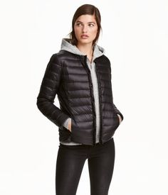 Black. PREMIUM QUALITY. Lightweight, fitted down jacket with a small stand-up collar. Snap fasteners at front, concealed side pockets, and narrow, concealed