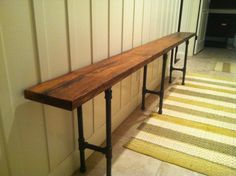 Black iron pipe reclaimed wood bench. $300.00, via Etsy. I feel like I could make this for way less... Entryway or behind couch?