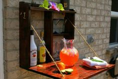 Back porch idea!  Serving Station.  Love this simple solution.  For more outdoor living ideas go to http://www.OutdoorRooms.net